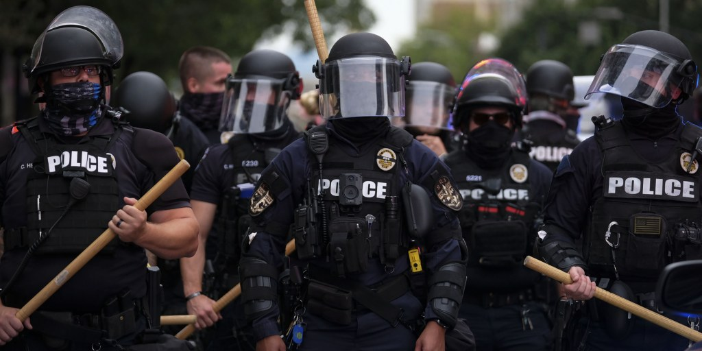 Feds charge Louisville police officer accused of striking kneeling protester with riot baton - NBC News