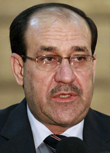 Image: File photo of Iraq's Prime Minister Nuri al-Maliki speaking during a news conference in Baghdad