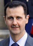 Image: Syria's President Bashar al-Assad speaks to the media after a meeting at the Elysee Palace in Paris