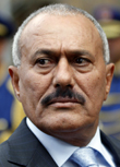 Image: Yemen's President Saleh reviews an honour guard at the Presidential Palace