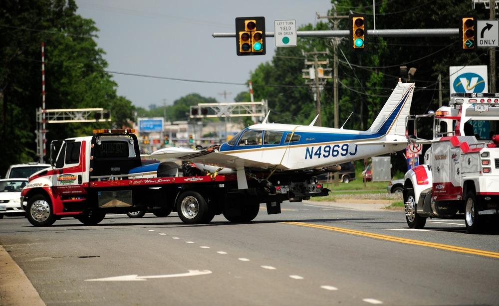 small plane crash lands at gas station after running out of fuel photoblog. Black Bedroom Furniture Sets. Home Design Ideas