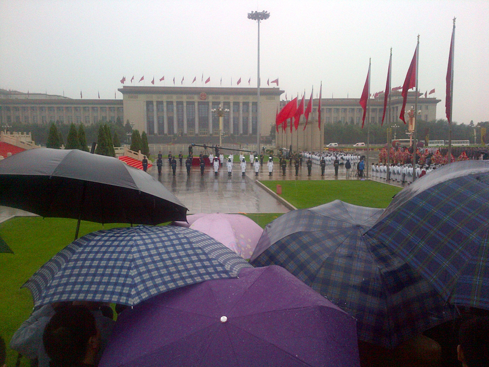Where were China's weather wizards? President gets soggy on rare rainy National Day