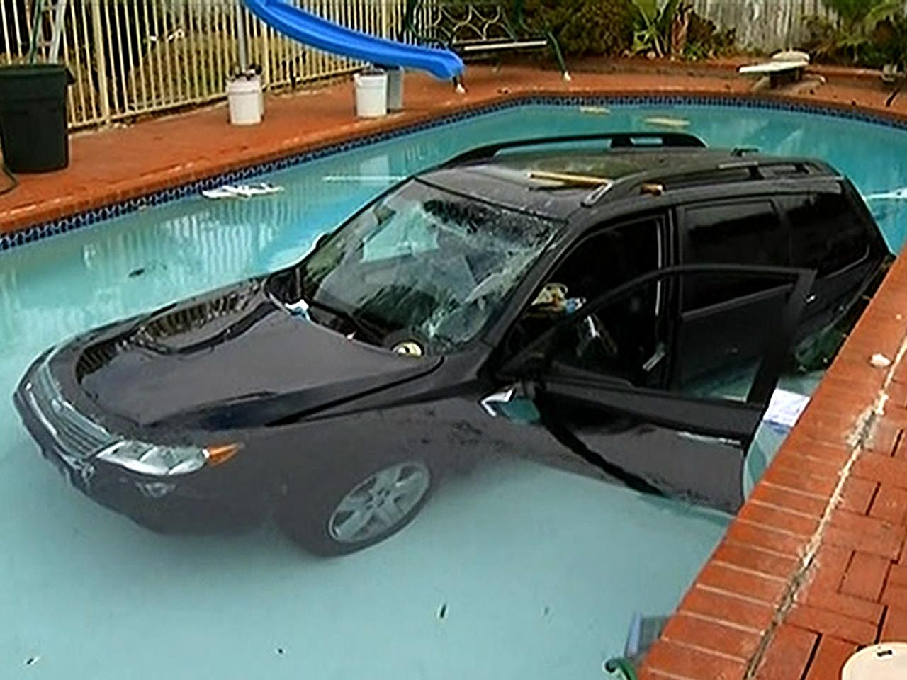 Car Crashes Into Garage