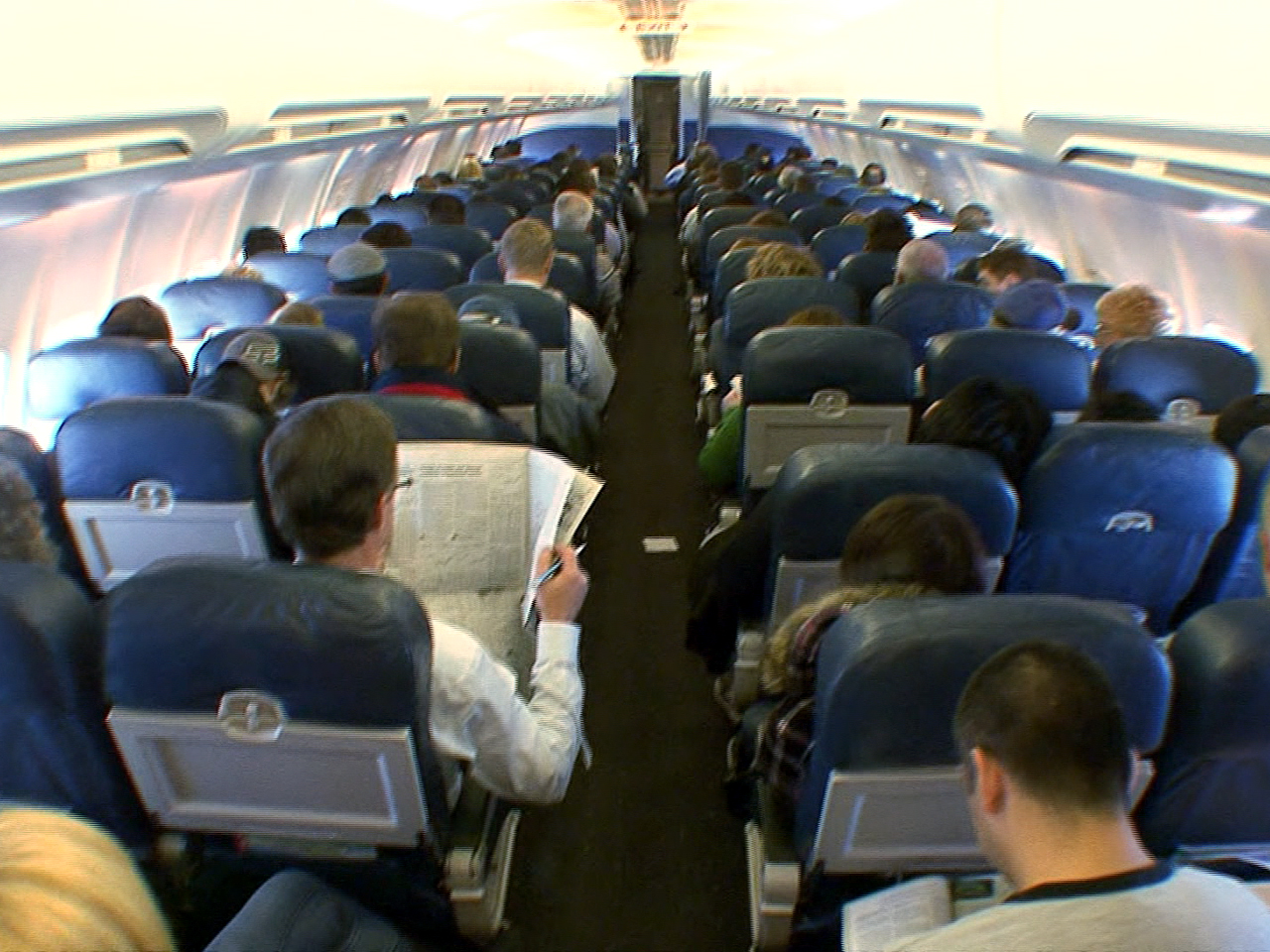 American Airlines to add more economy seats