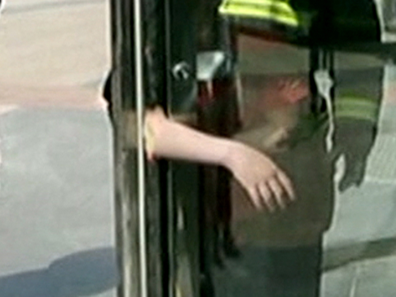 & Boy gets arm trapped in revolving door