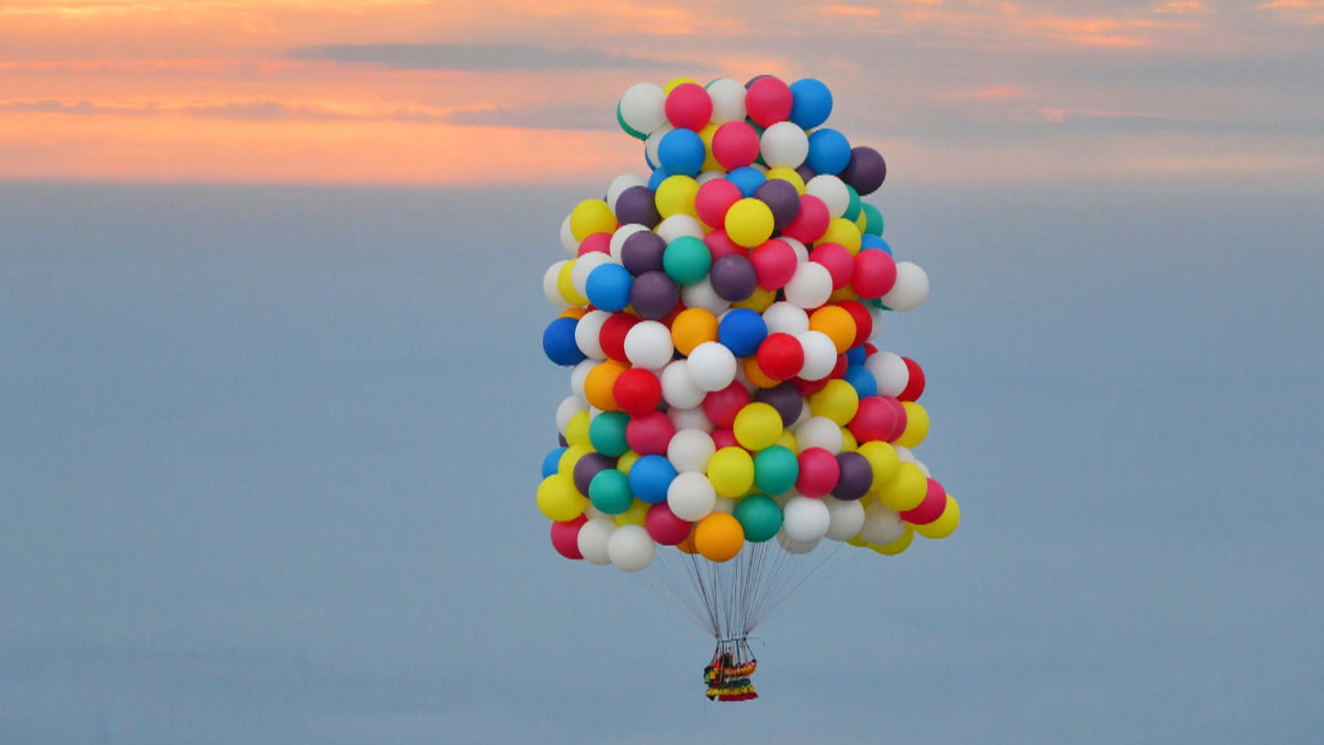 up up and away man tries flying with just balloons