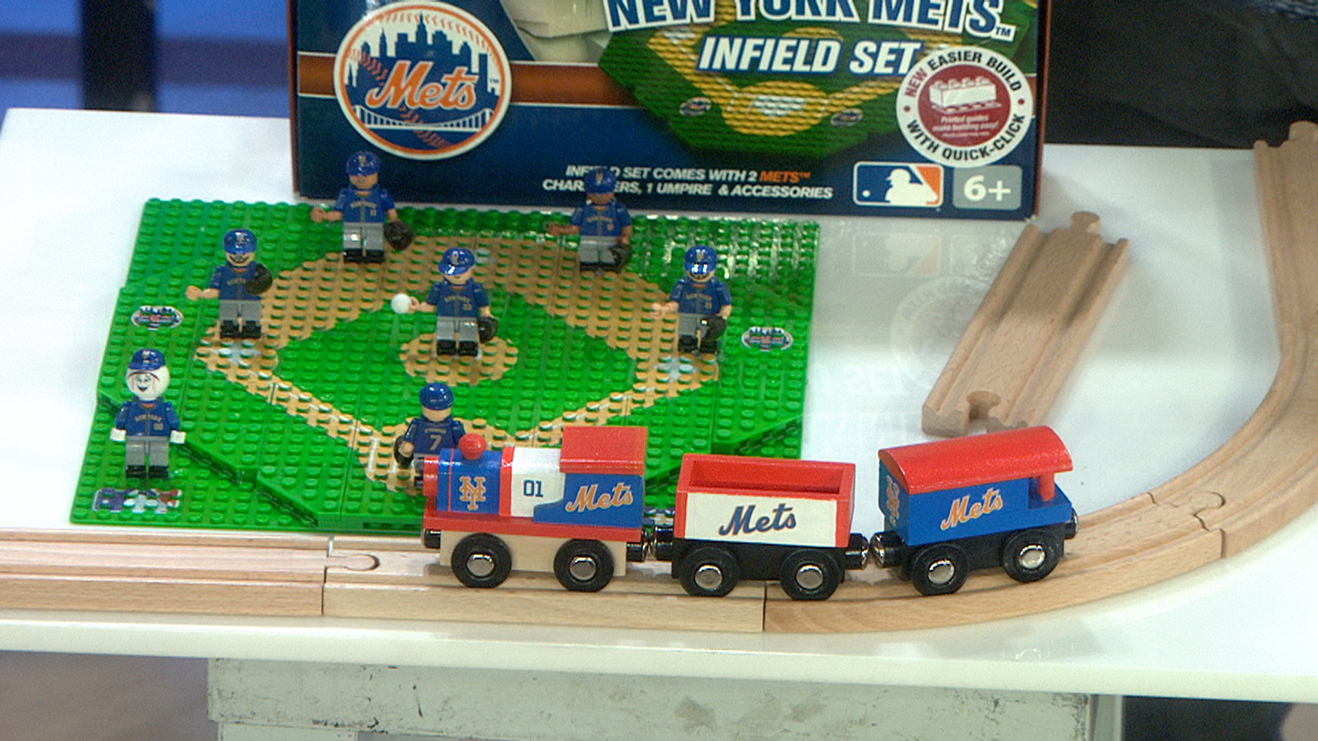 mlb  masterpieces puzzle company and oyo give toys to kids in need