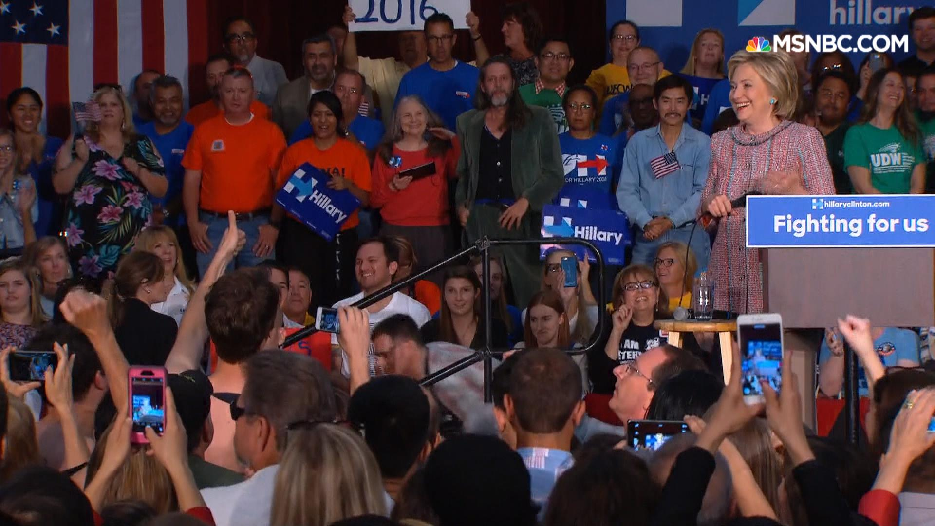 Clinton addresses her shirtless supporters