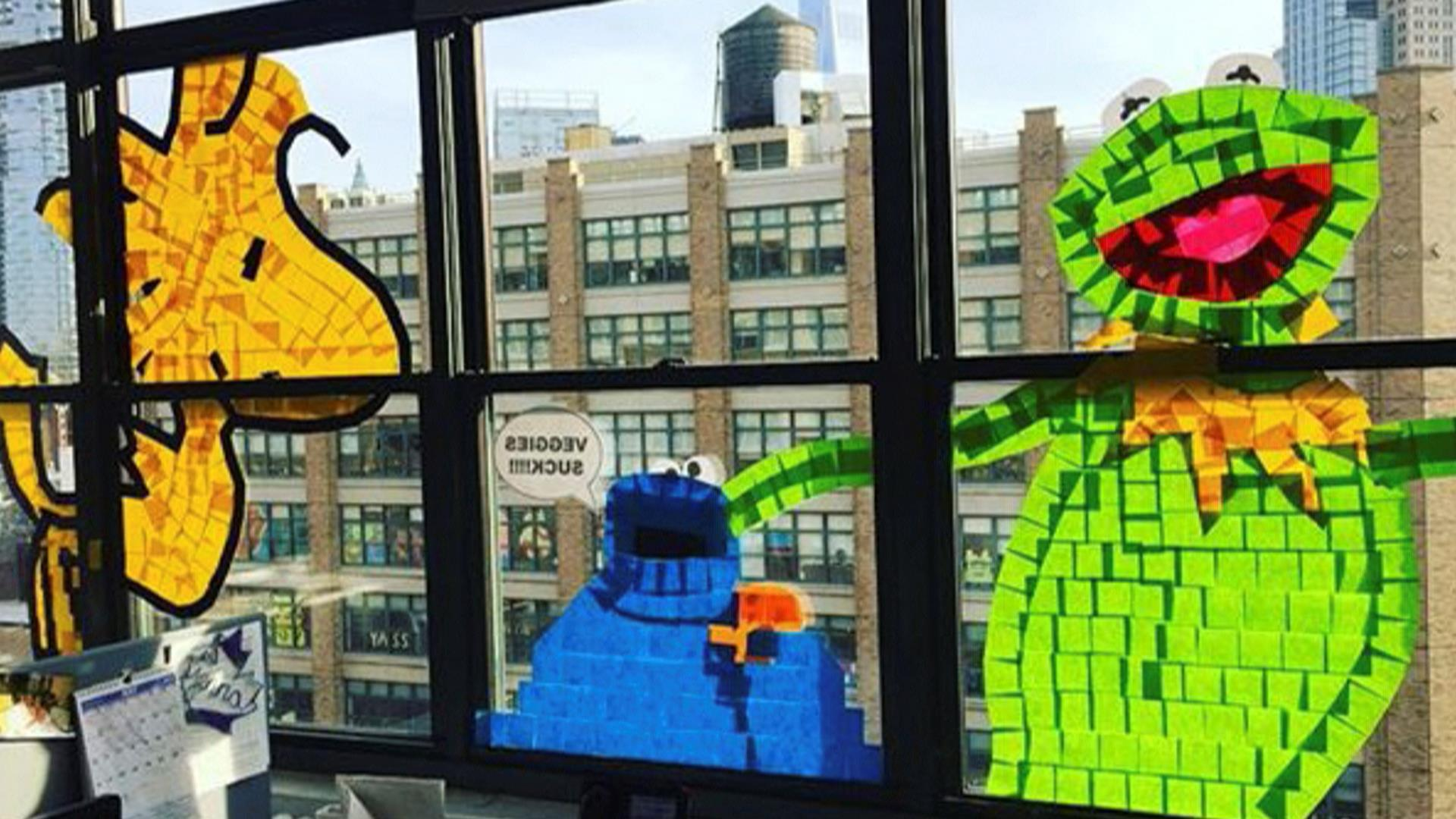 epic post it war plasters nyc office windows with playful designs. Black Bedroom Furniture Sets. Home Design Ideas