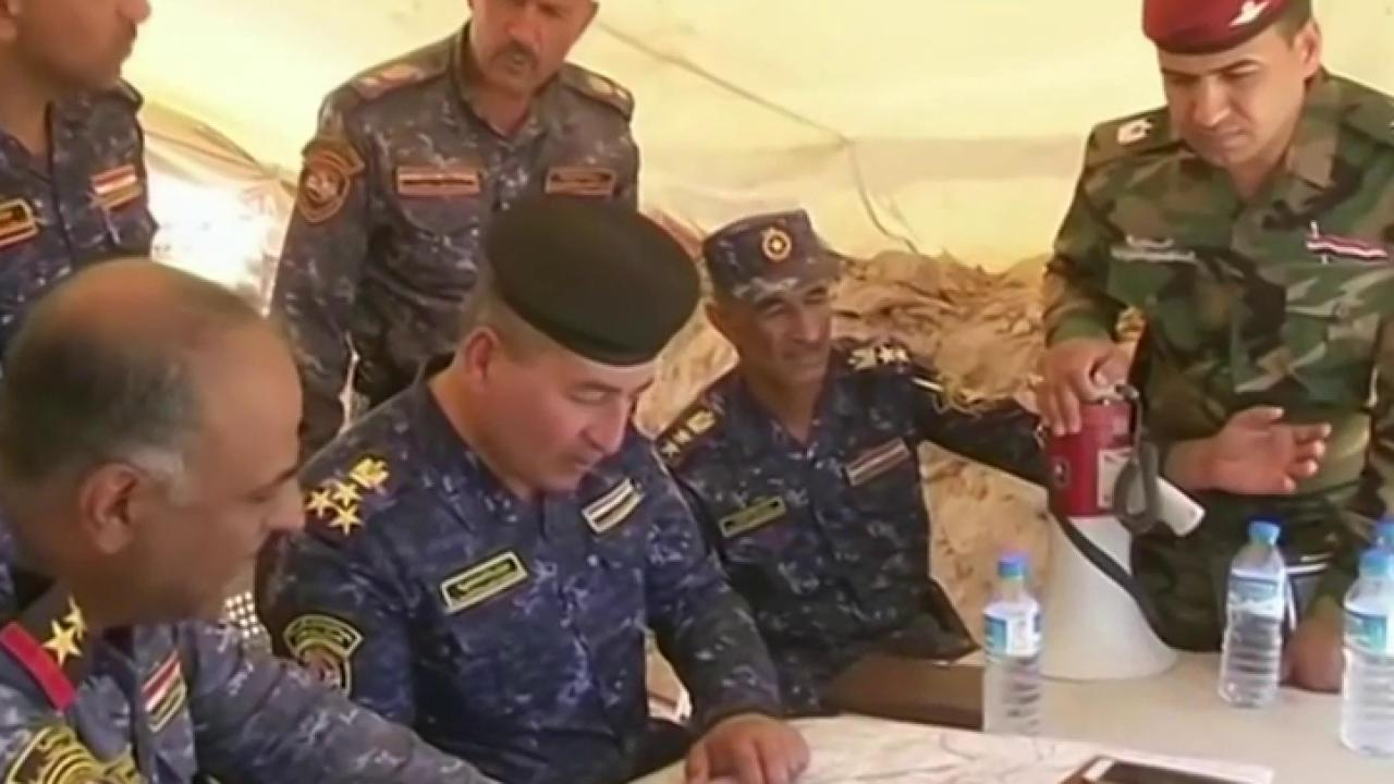 Iraqi forces continue assault on ISIS-held...
