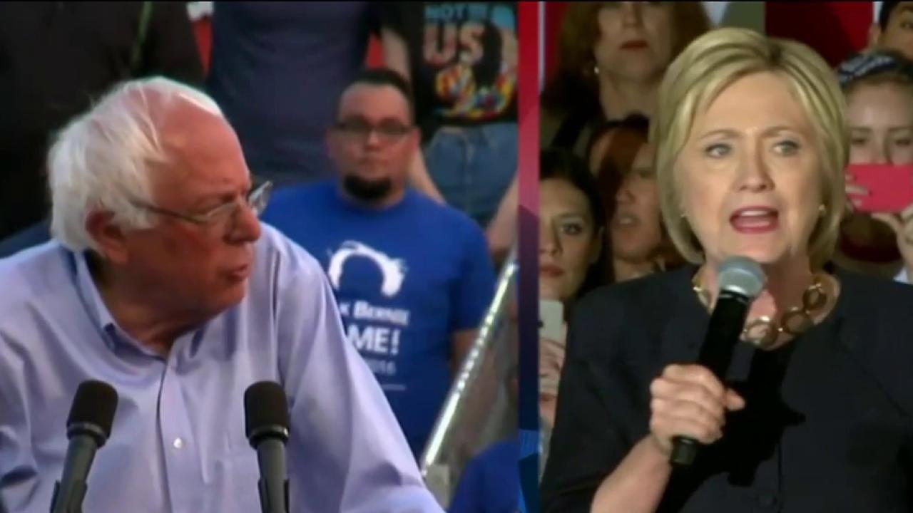 Sanders continues race as Clinton nears ...