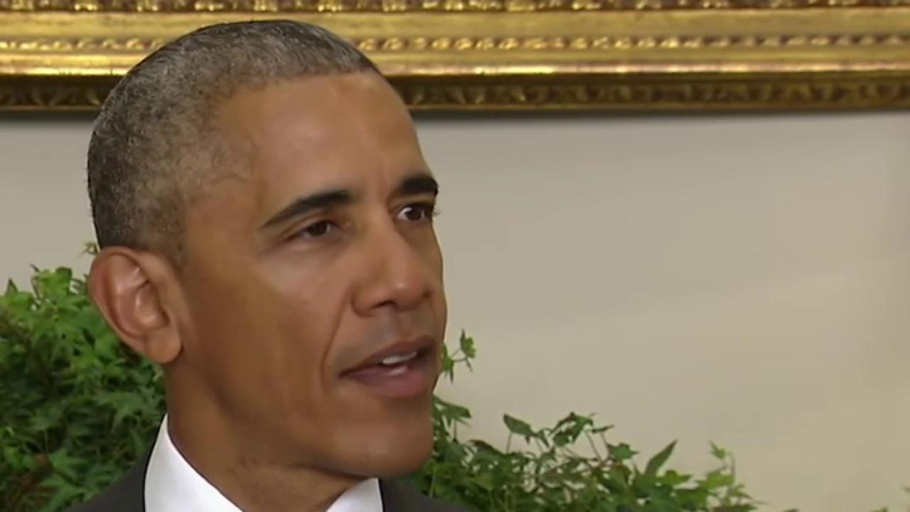 Obama slows Afghanistan troop withdrawal