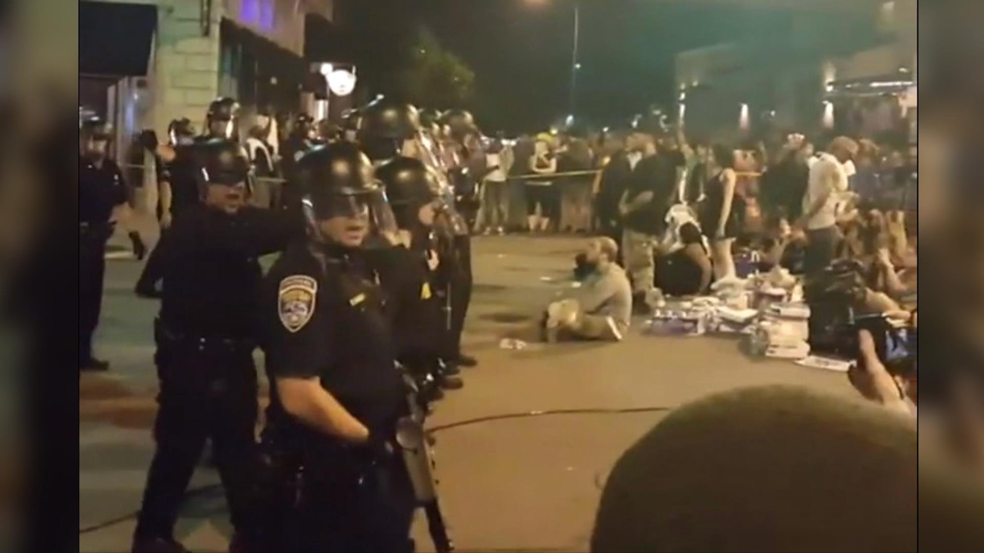 Baltimore police officers in riot gear push protestors back along - More Than 100 Arrested At Baton Rouge Rochester Black Lives Matter Protests Nbc News