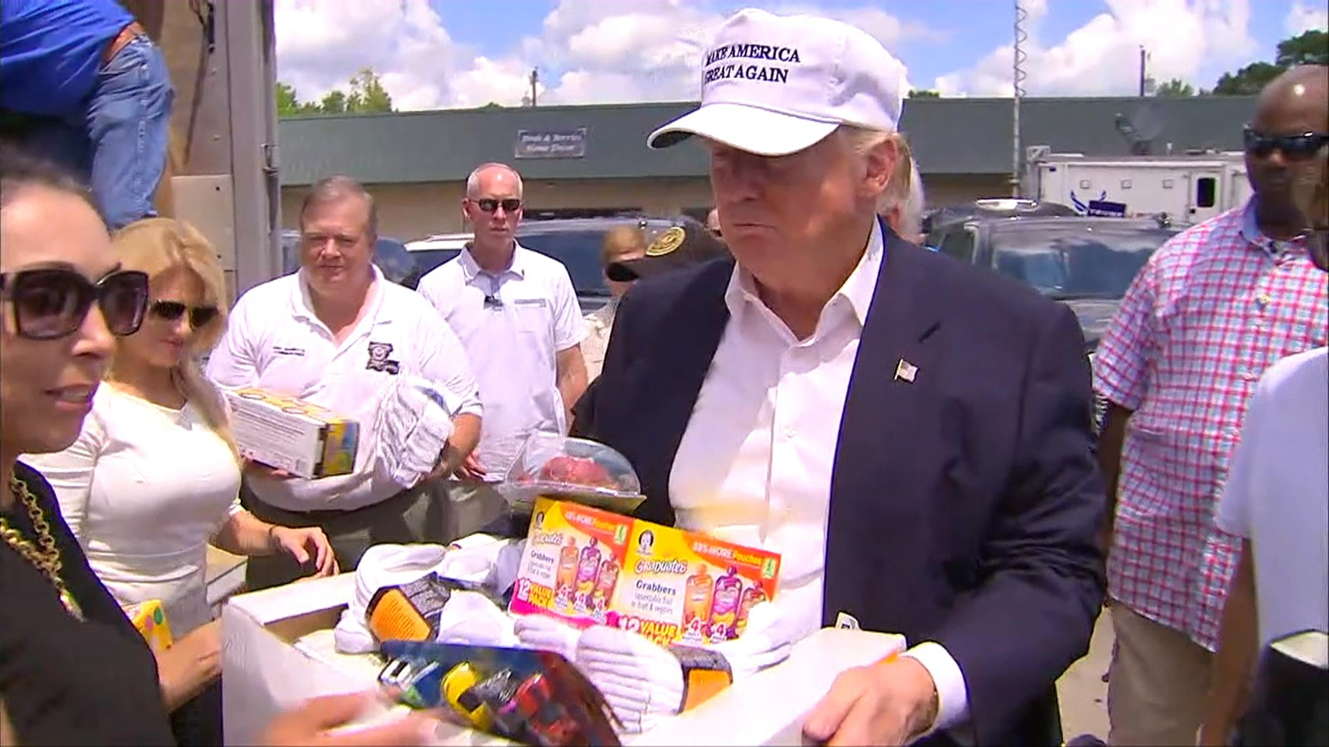 Donald Trump Hands Out Supplies to Louisiana Flood Victims ...