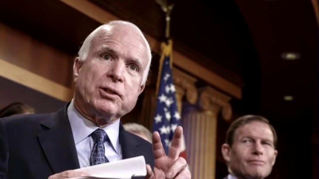Trump continues to take hard shots at McCain