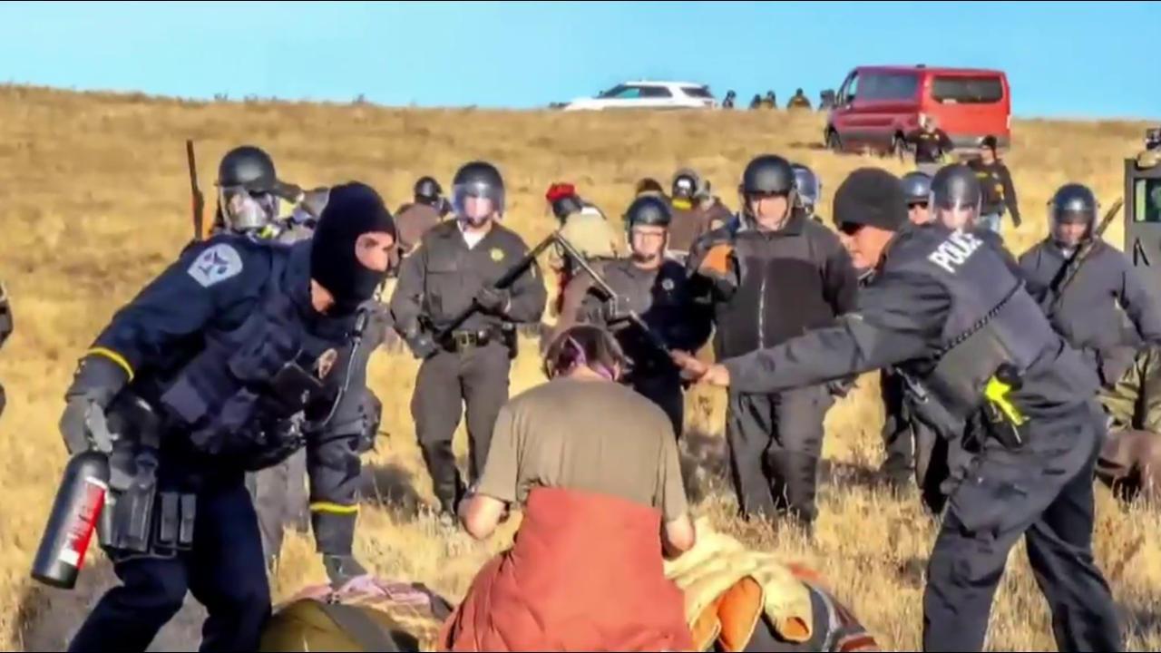 Police Clad in Riot Gear Move in On Dakota Access Pipeline Protesters