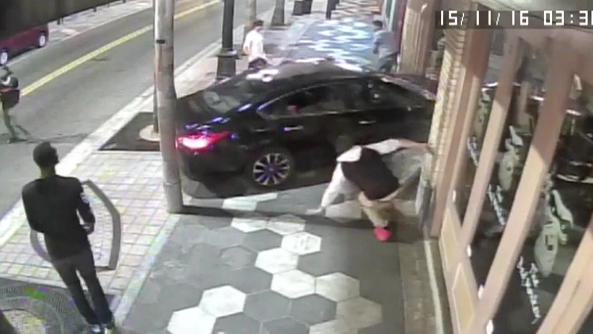Watch car crash through bar window at end of Tampa street fight