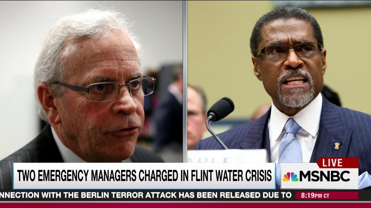 Two officials charged in Flint water crisis