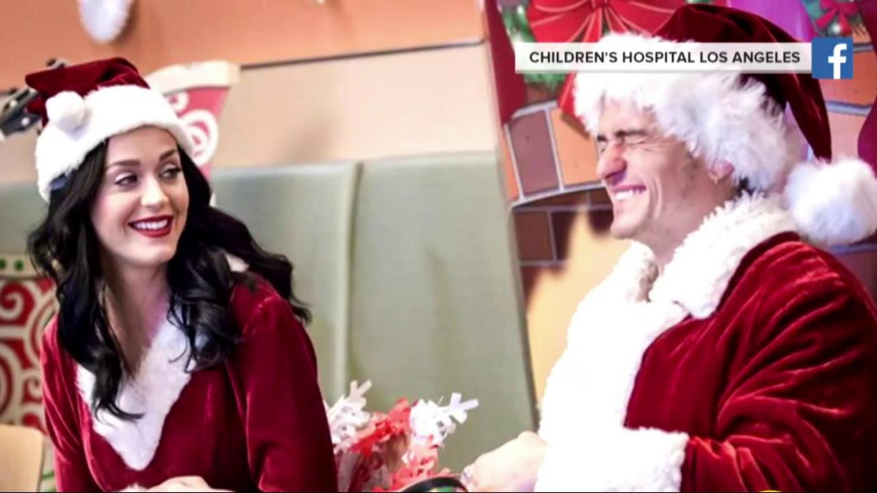 Katy Perry and Orlando Bloom play Santa & Mrs. Claus at LA ...
