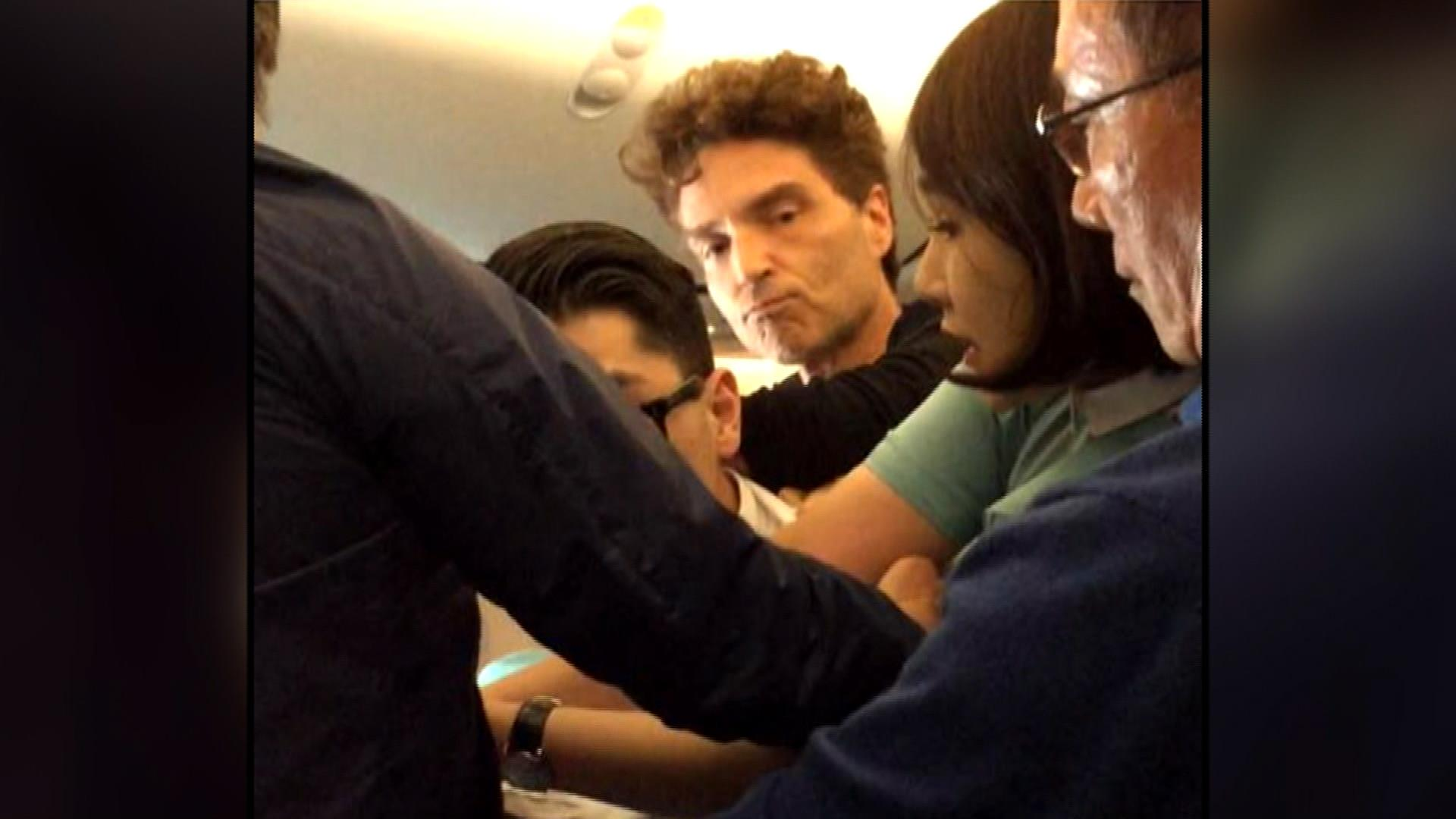 singer richard marx help restrain man on plane wife daisy fuentes