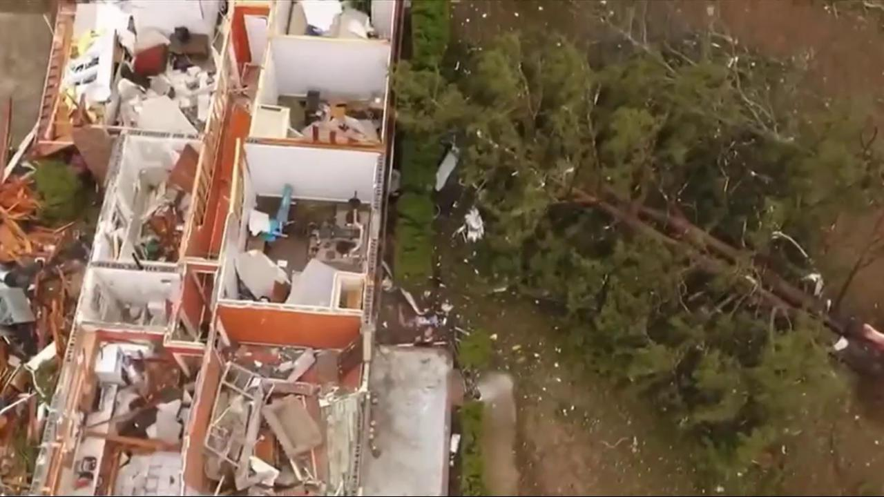Devastating storms leave at least 18 dead