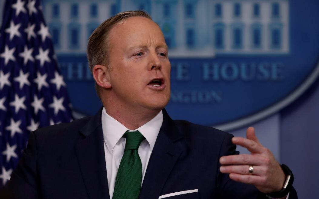 Combative & agitated, Spicer again defends...
