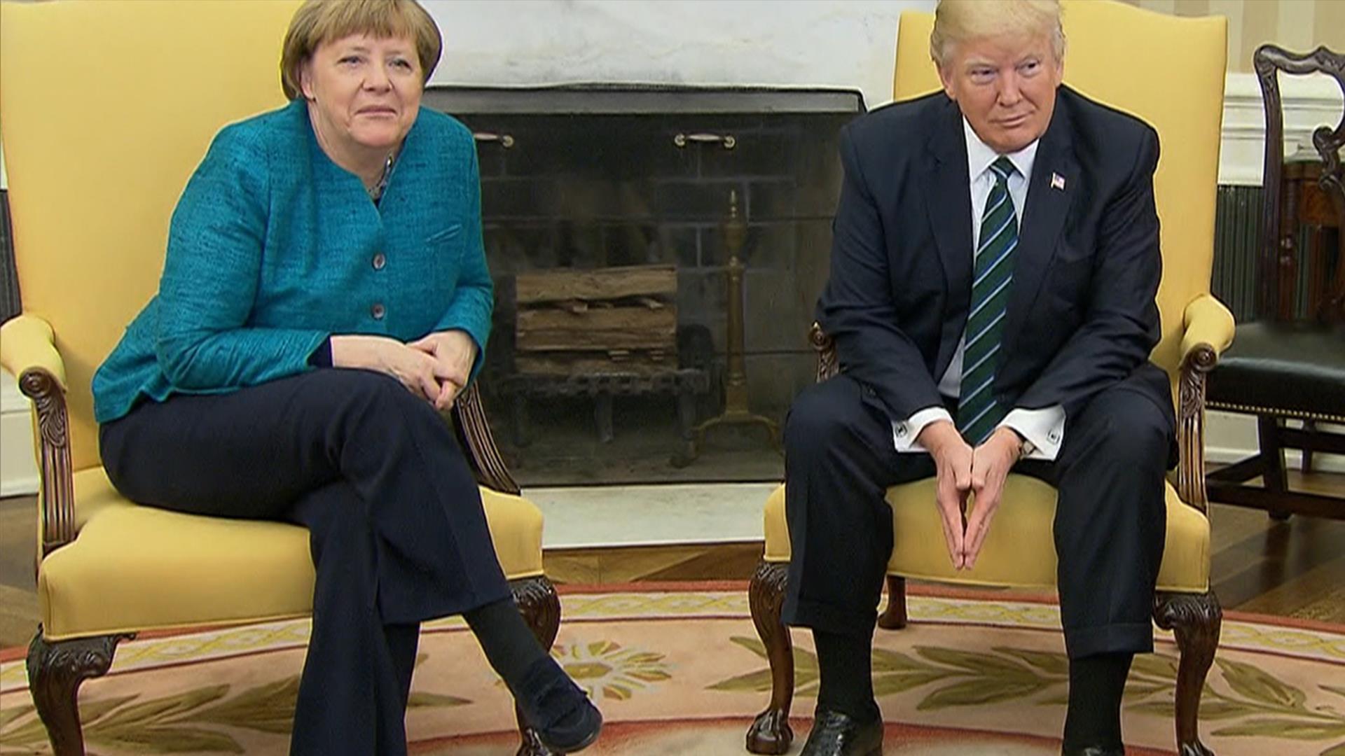 Donald Trump, Angela Merkel avoid handshake during photo op.