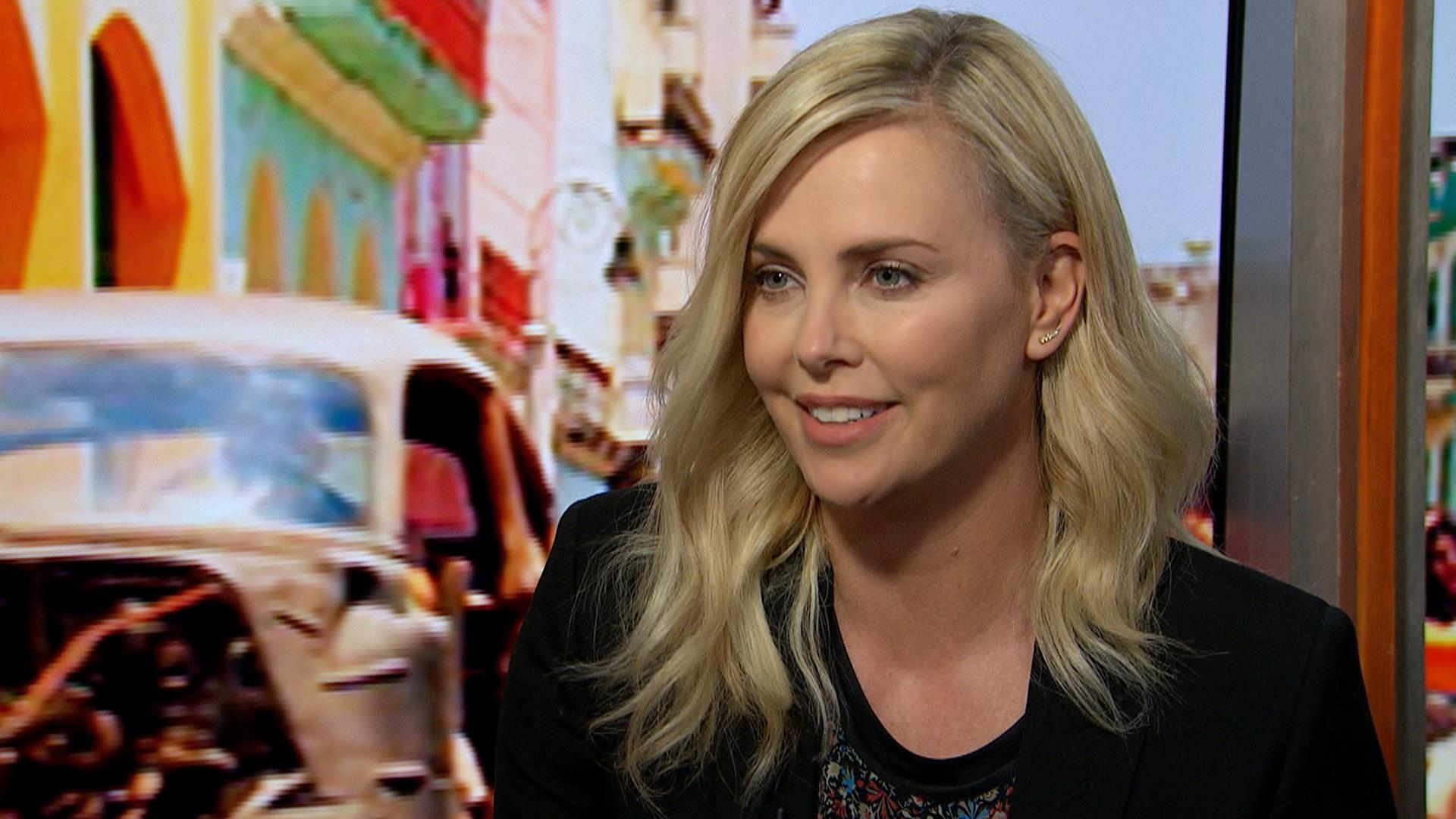 charlize theron on fate of the furious i sit in a chair and say mean things. Black Bedroom Furniture Sets. Home Design Ideas