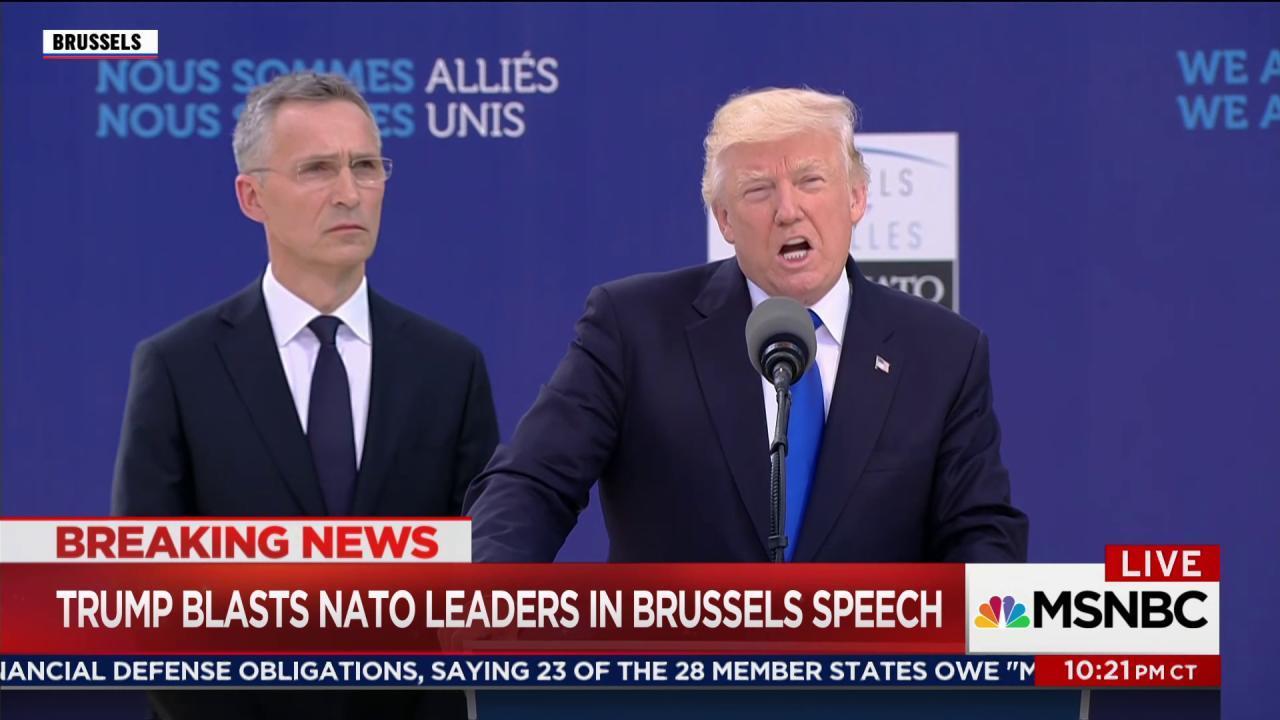 Stone-faced world leaders listen as Trump...