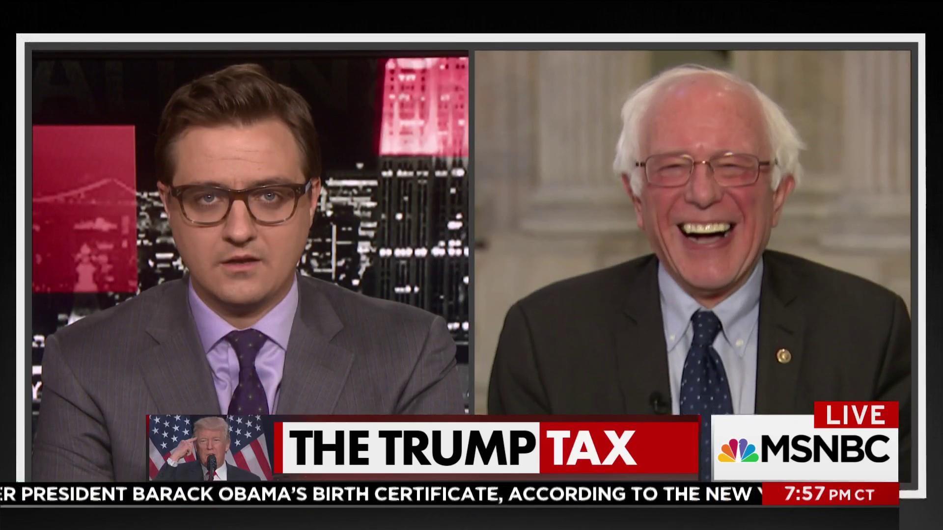 Bernie Sanders laughs at the president