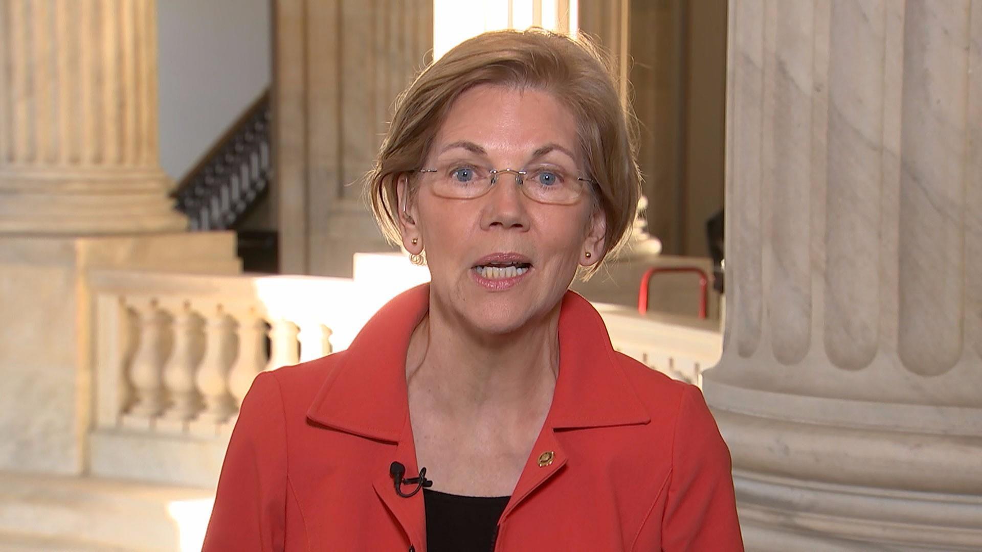 Elizabeth Warren reacts to Donald Trump calling her