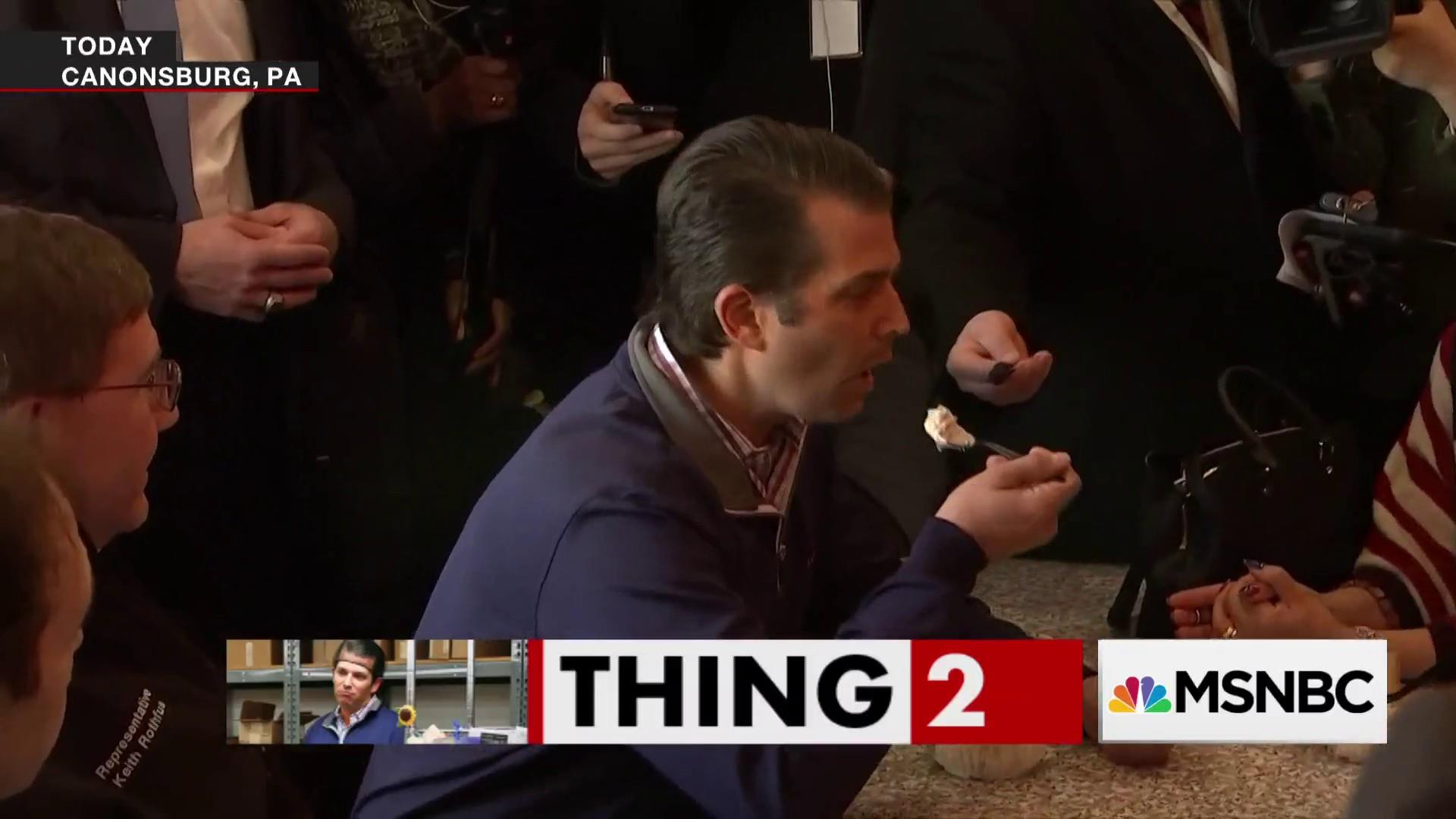 Trump Jr. talks to the press with big bowl of ice cream
