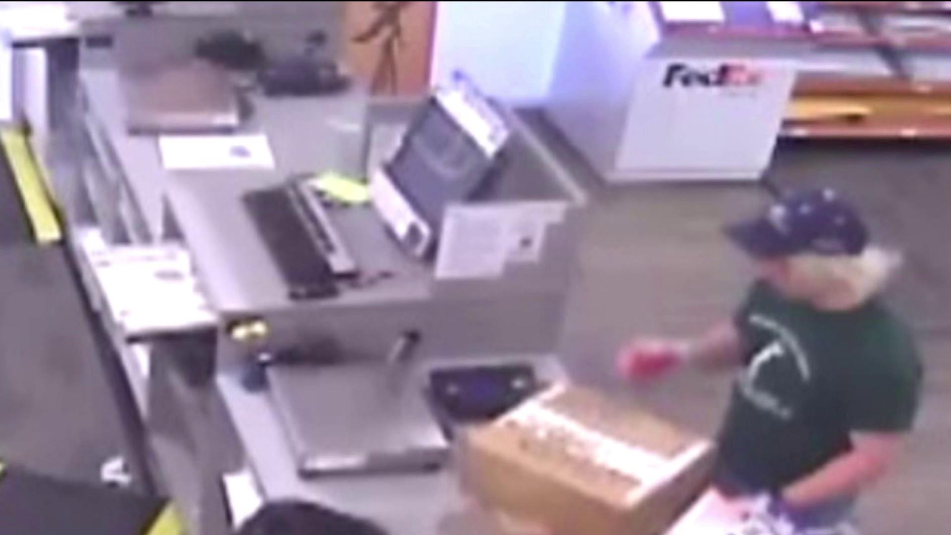 images show austin bomber dropping off packages at fedex