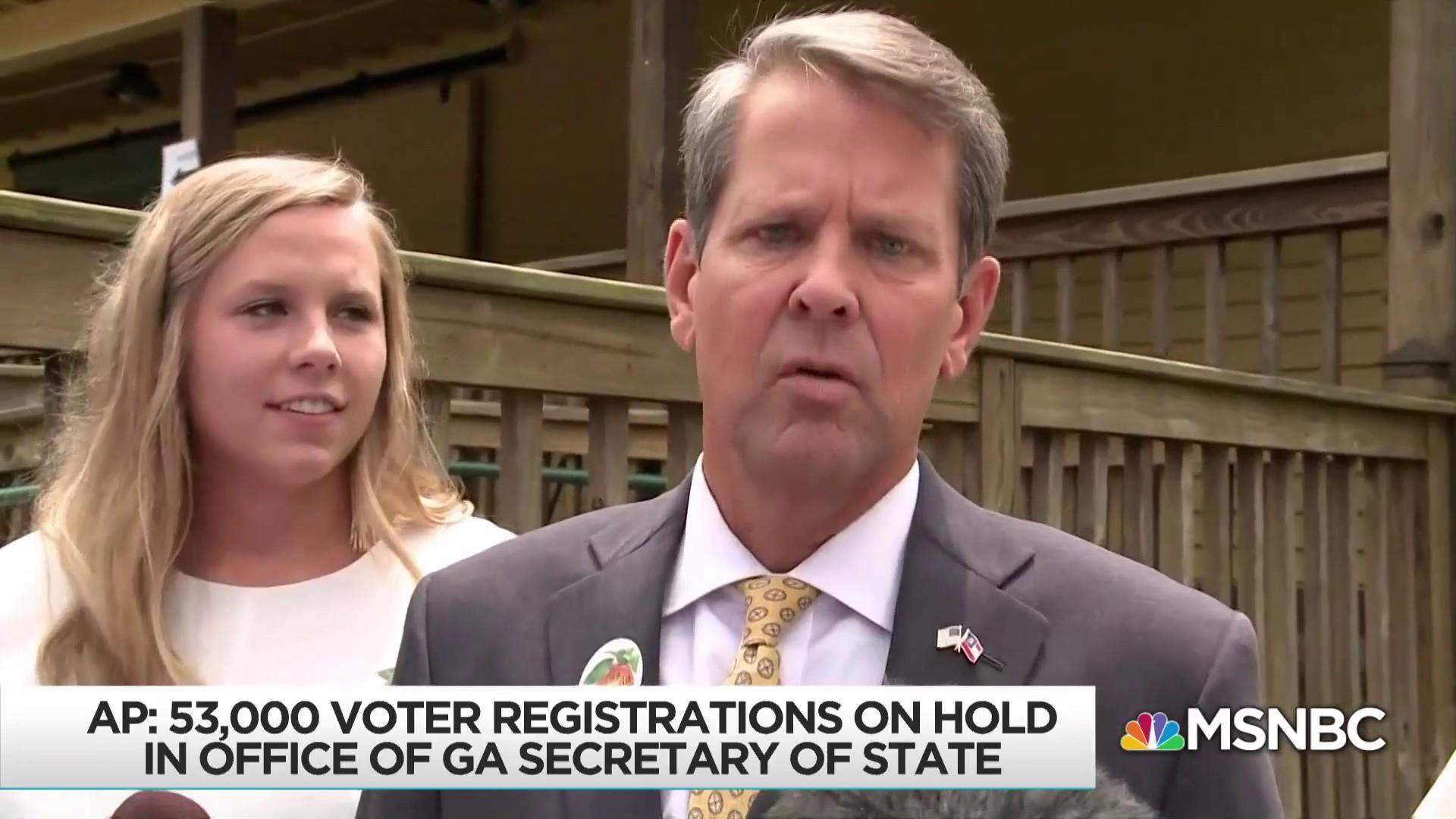 Kemp holding up 53K voter registrations as he runs for governor