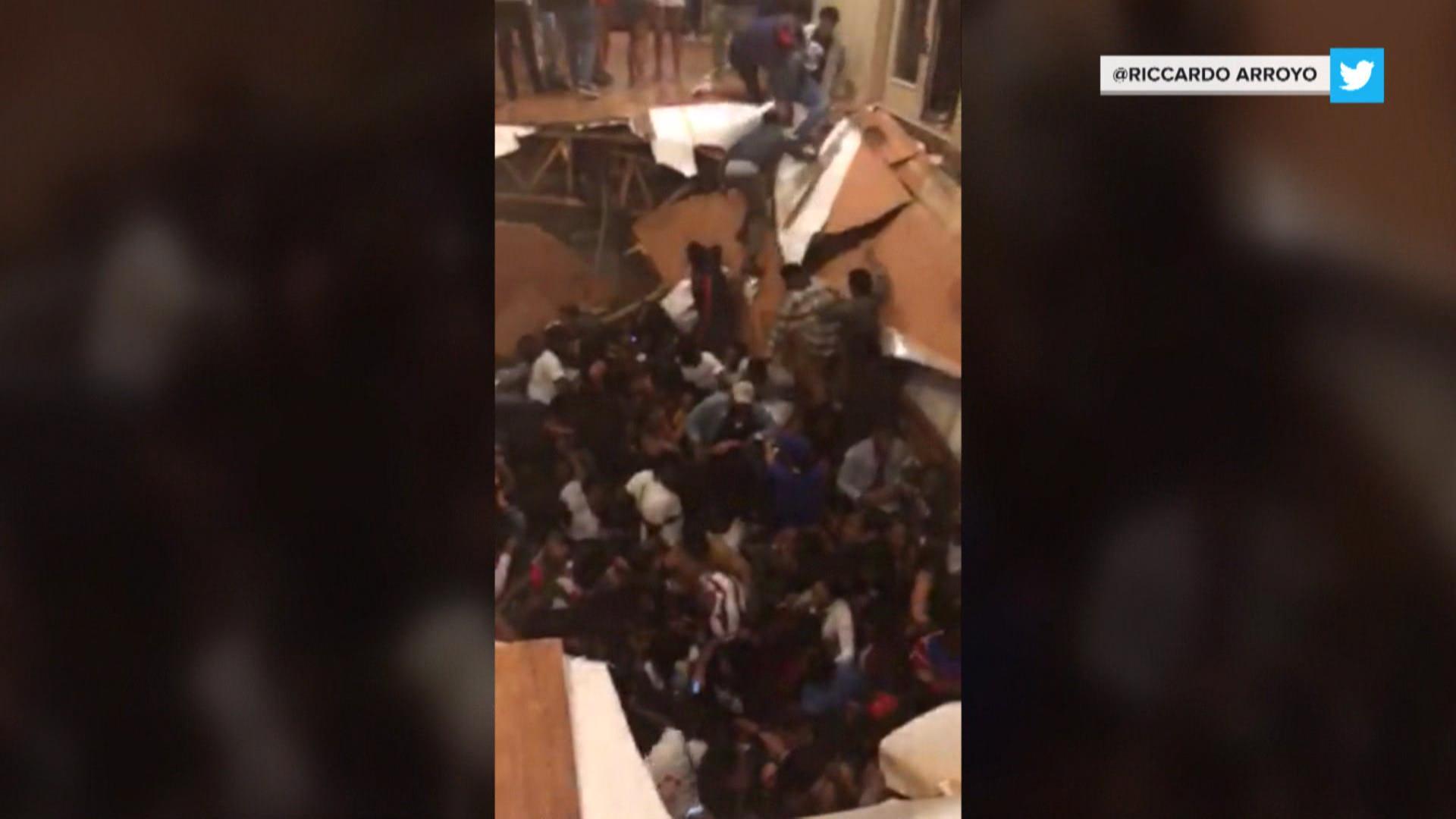 Dozens injured after floor collapses