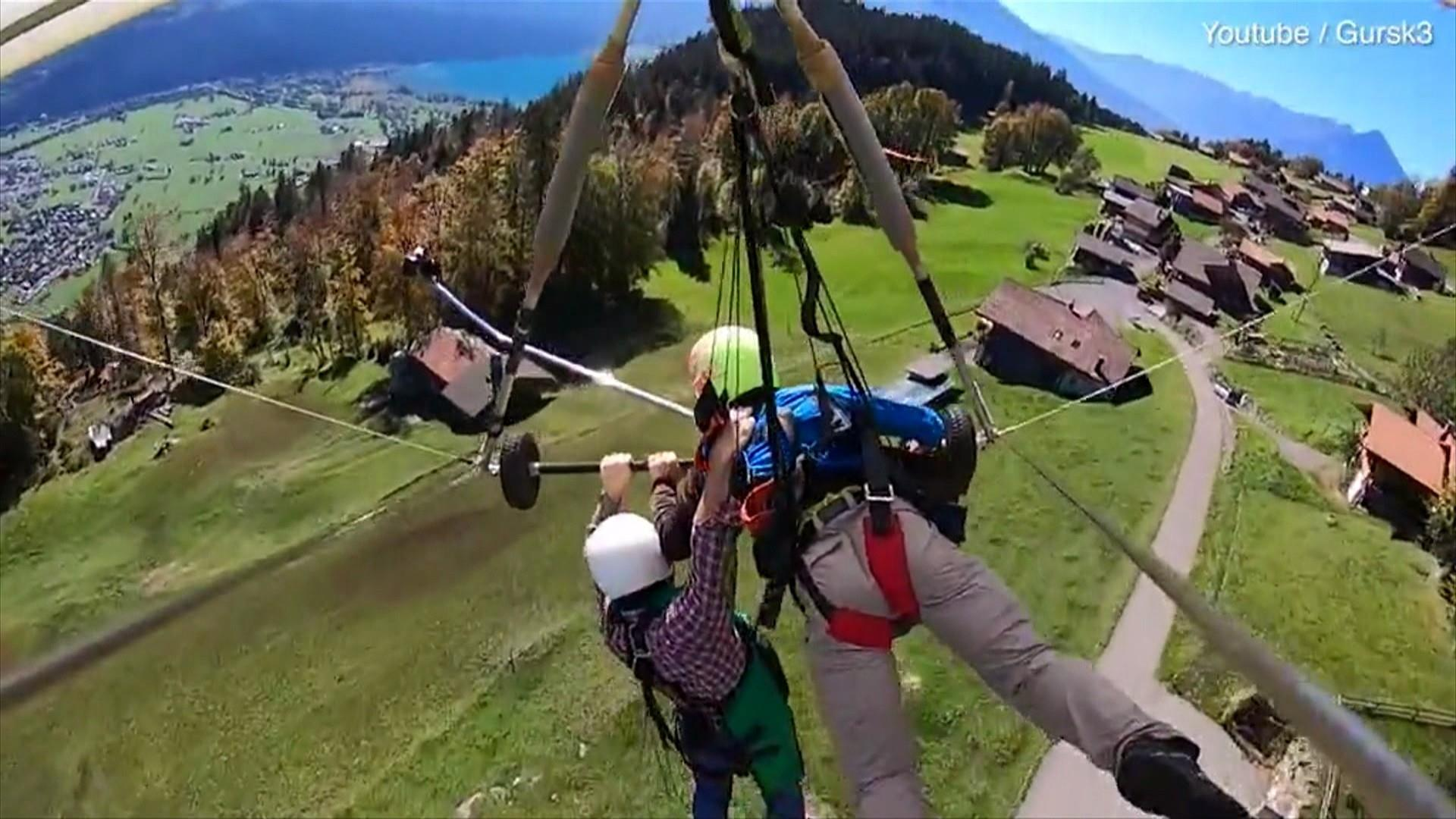 watch hang glider holds on for dear life after realizing he s not