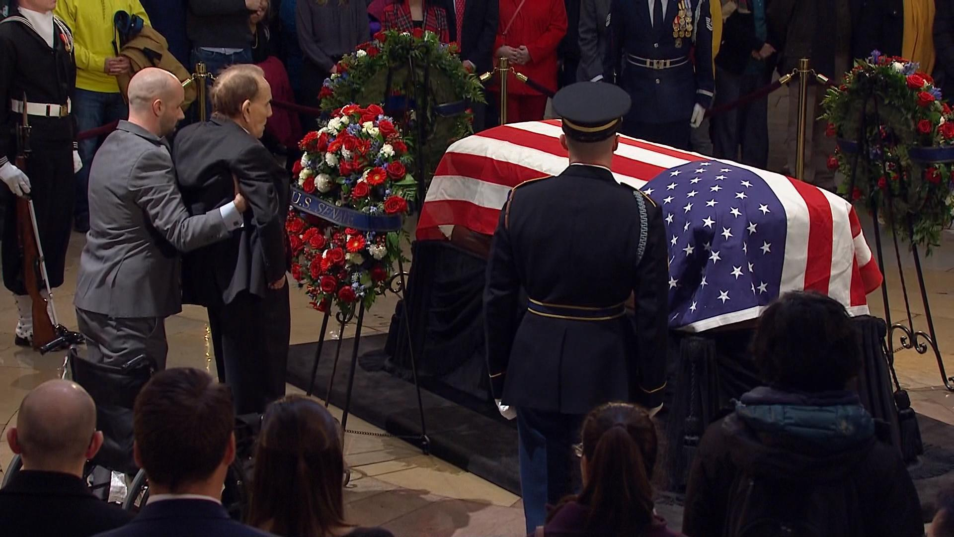 Watch Bob Dole salute George H.W. Bush's casket in powerful moment at Capitol