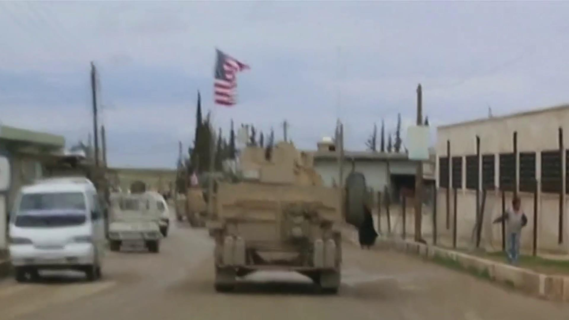 U.S. to withdraw troops from Syria, Trump declares ISIS 'defeated'
