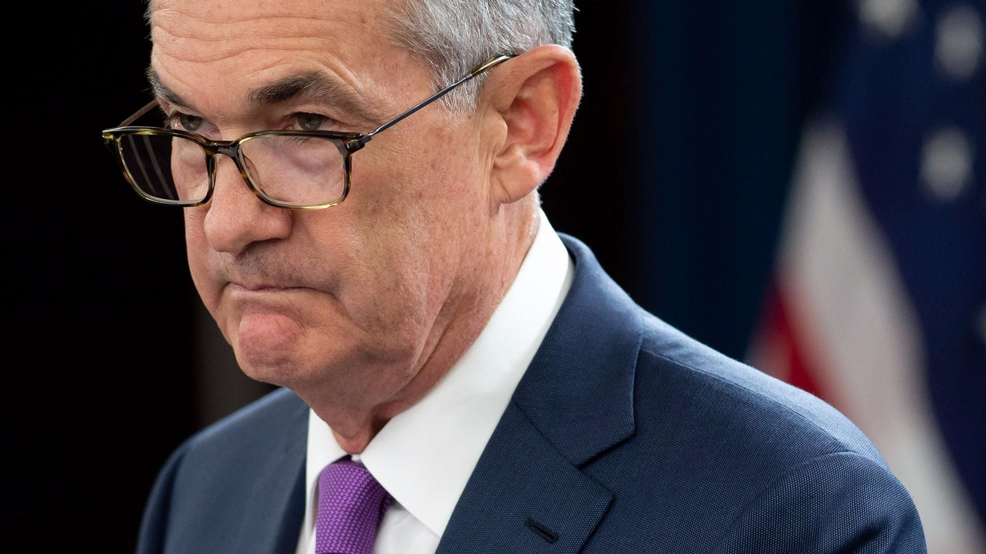 Fed hikes rates by a quarter-point despite attacks from the president