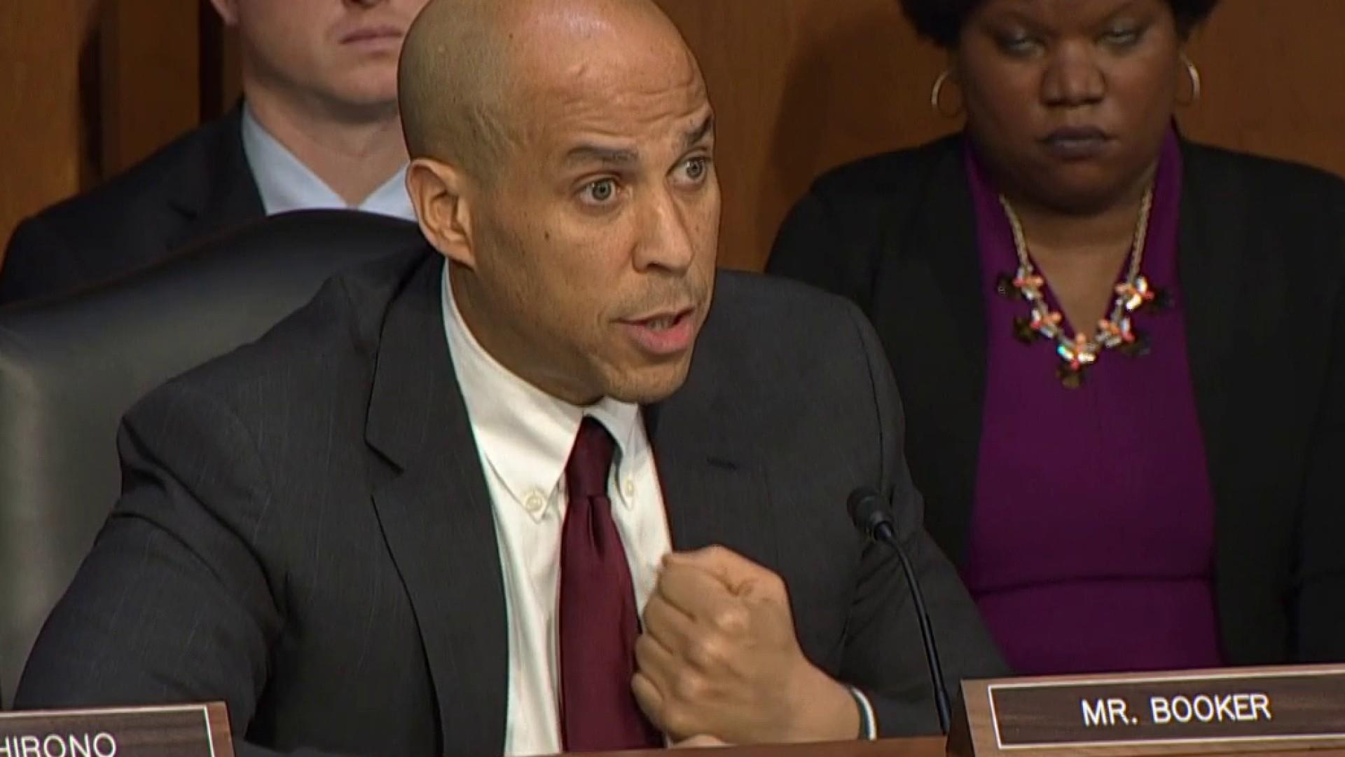 Barr and Booker debate whether or not race factors into incarceration and the justice system