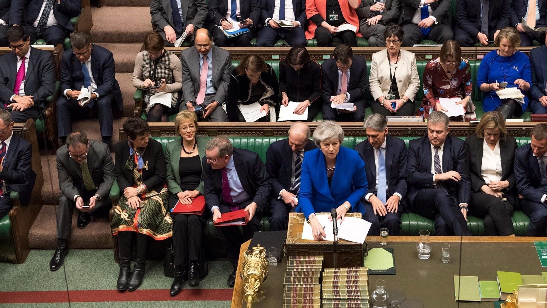 Theresa May narrowly survives no-confidence vote after Brexit plan is crushed