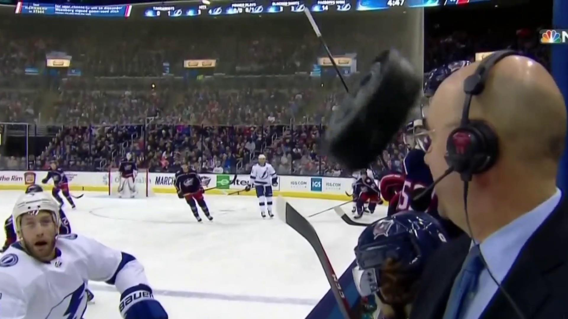 Sports Reporter Comes Close To Getting Knocked In The Head By Hockey