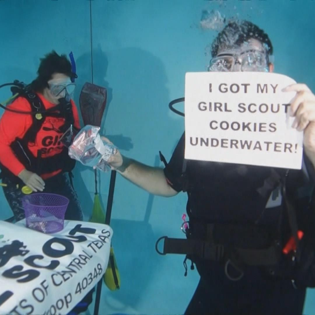 Scuba Girl Scout troop sells cookies underwater