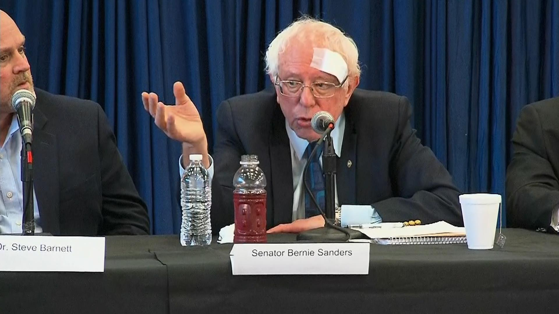 Bernie Sanders, wearing a bandage, discusses 'Medicare for All'