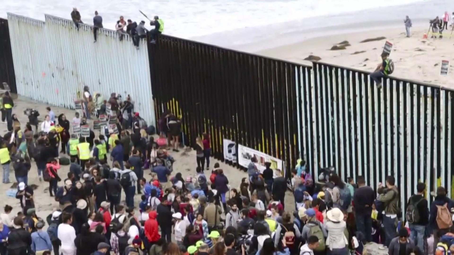 What force is driving the surge in migrants at the U.S. border?