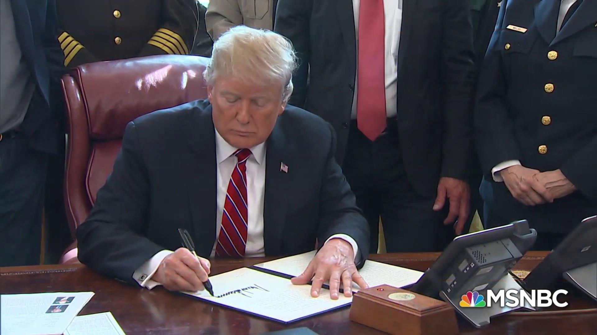 Trump signs his first veto over his border wall, the cornerstone of his political brand