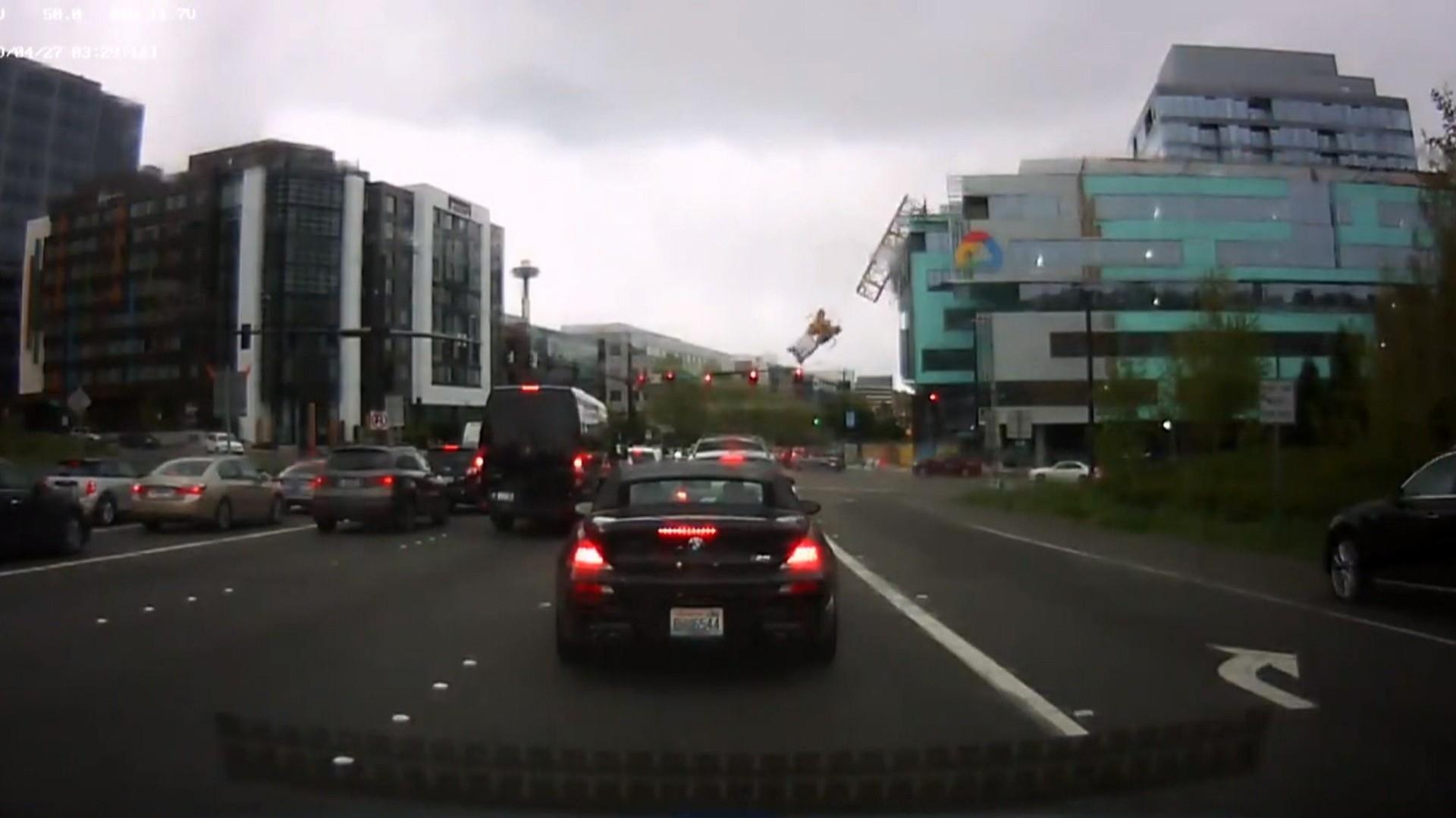 Seattle crane accident video shows it hitting a building before falling onto cars below
