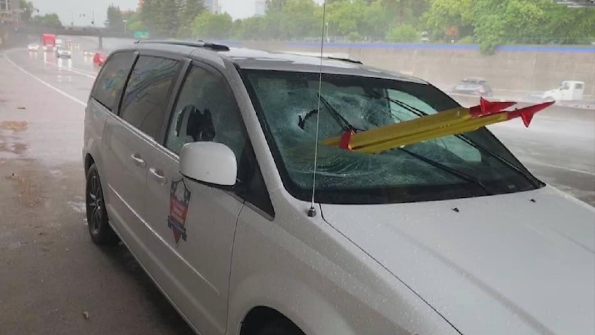 Tripod impales windshield of van in California
