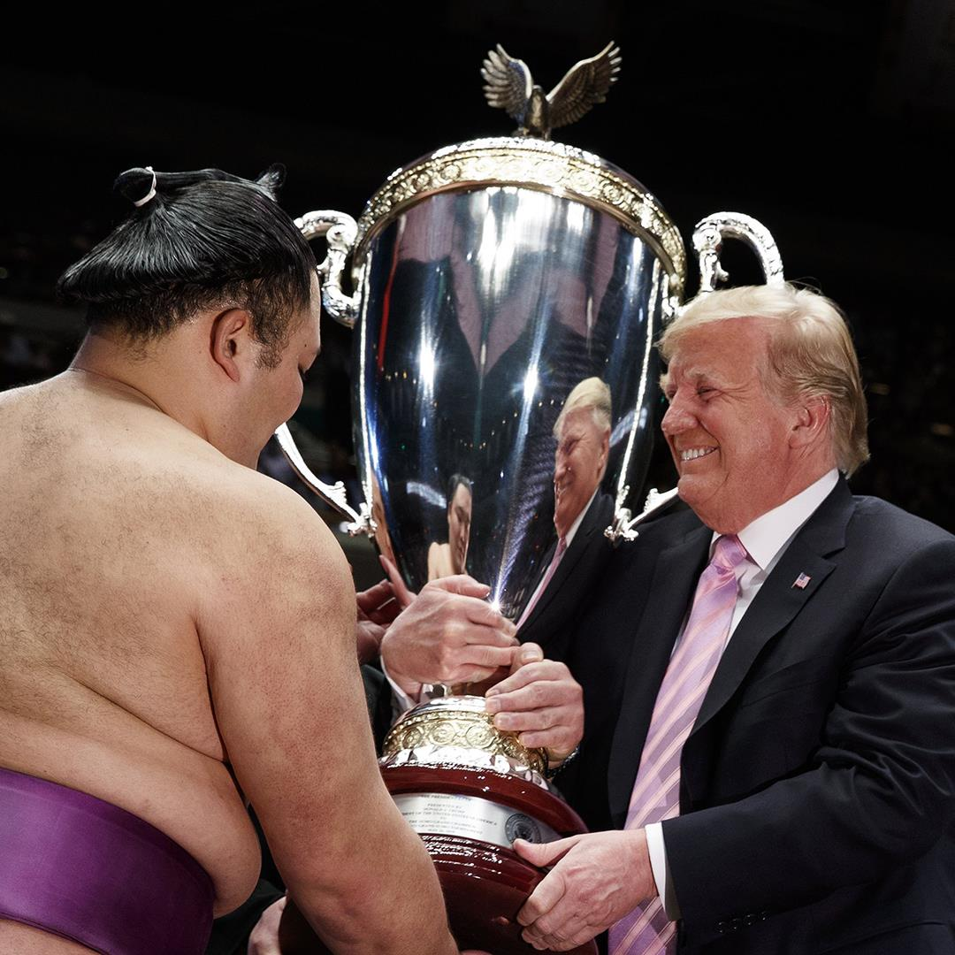 Trump awards sumo trophy as Tokyo charm offensive continues