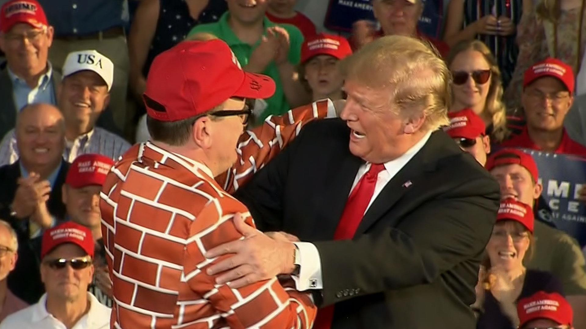 Trump invites man dressed as border wall on stage at campaign rally